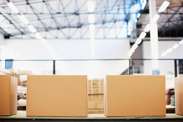 boxes in row in shipping area - production line stock photos and pictures