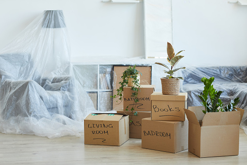 Image of signed cardboard boxes on the floor in the new apartment
