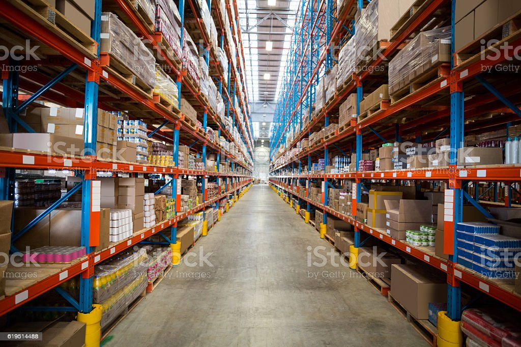 Boxes kept on shelves in the warehouse stock photo