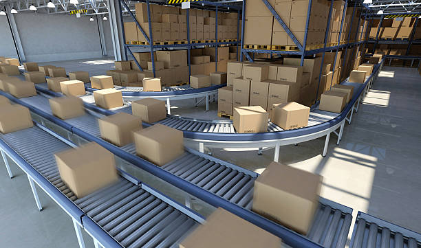 boxes moving on conveyor belt inside warehouse, ready for delivery - conveyor belt stock pictures, royalty-free photos & images