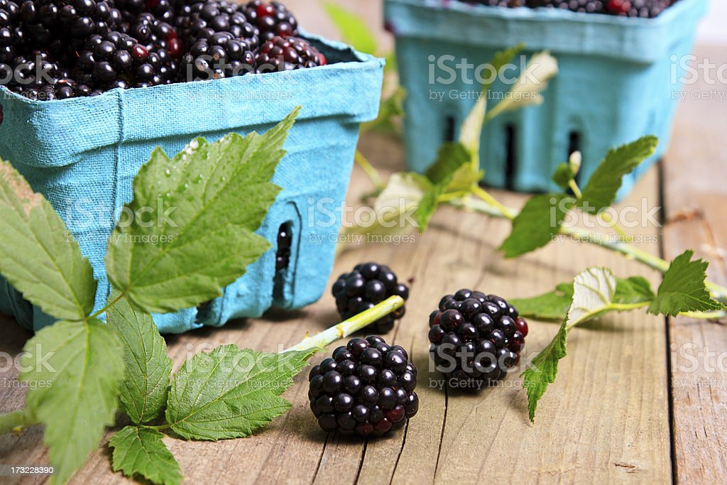 Boxes Of Blackberries With Leaves On Wood royalty-free stock photo