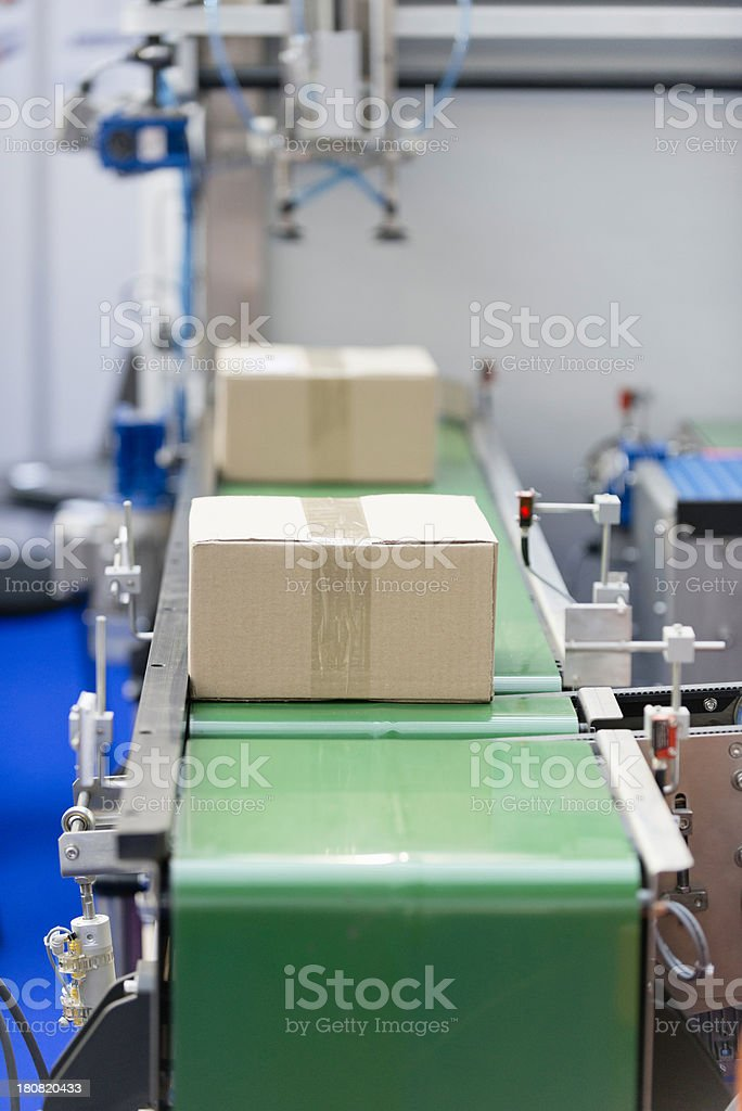 Boxes on a conveyor belt stock photo
