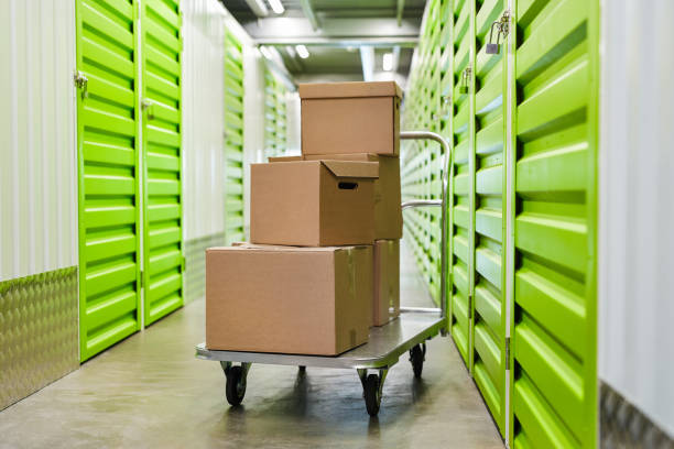 Boxes on Cart in Storage Unit stock photo