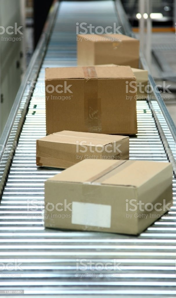 boxes on conveyor belt royalty-free stock photo