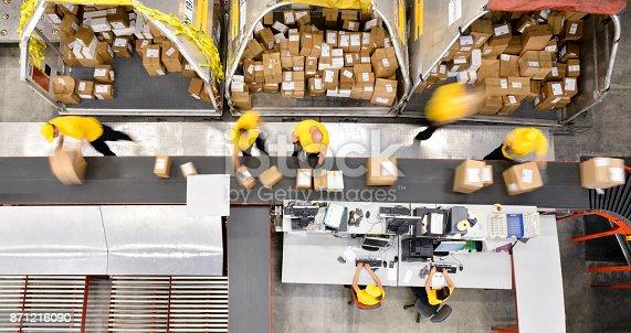 istock Boxes on conveyor belt 871216090