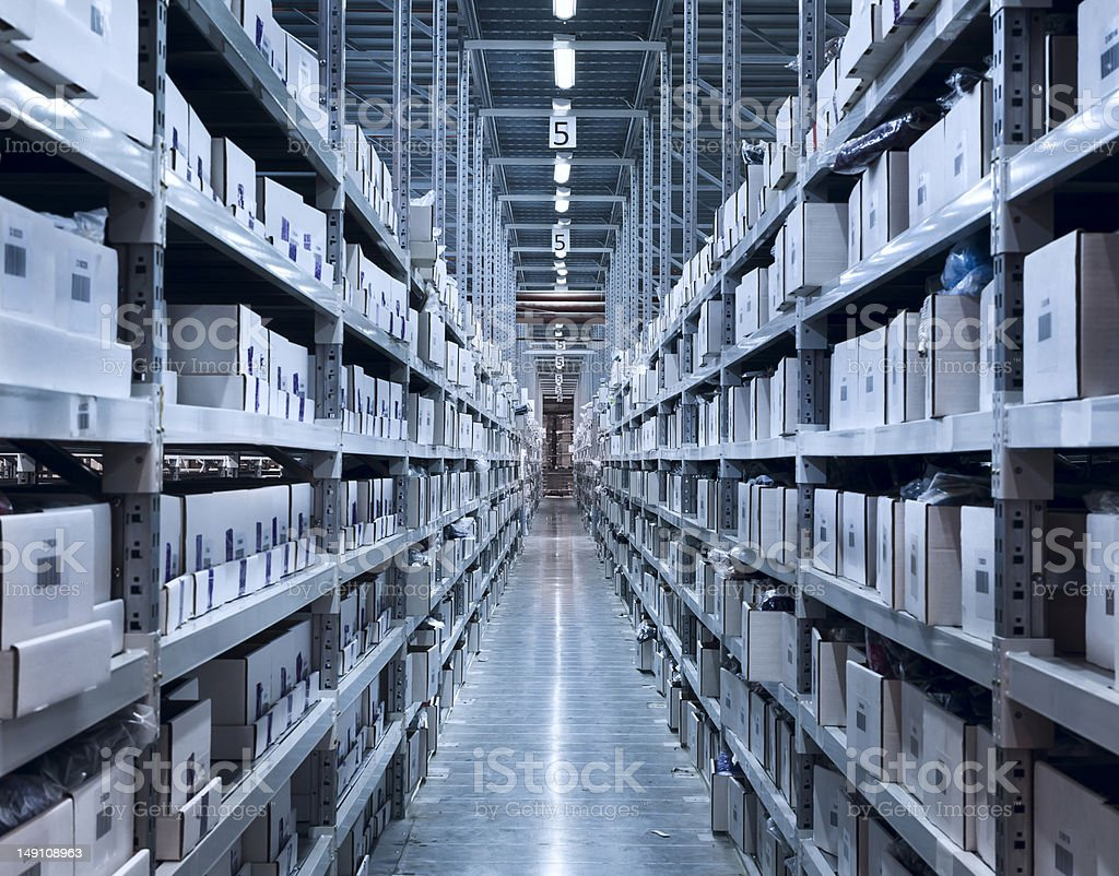 Boxes on shelves in a well lit modern warehouse royalty-free stock photo
