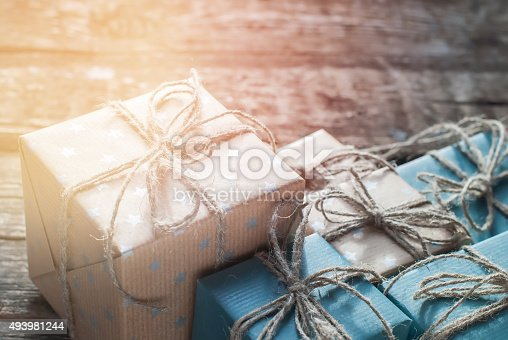 493890050 istock photo Boxes Packed into a Brown Paper with Linen Cord 493981244