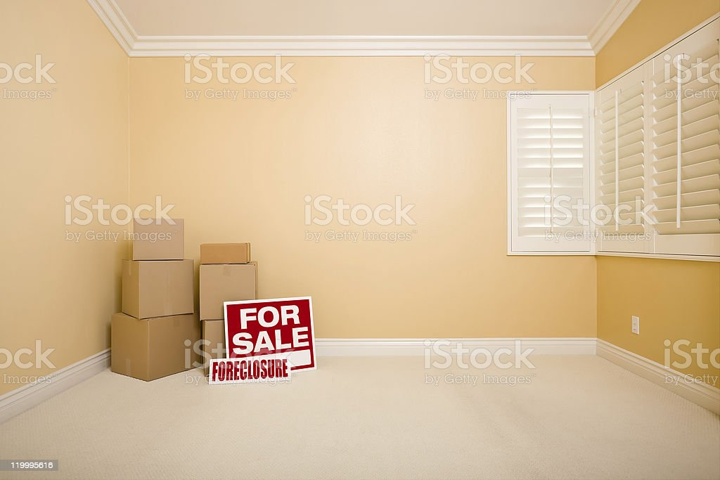 Boxes, Sale and Foreclosure Real Estate Signs in Empty Room stock photo