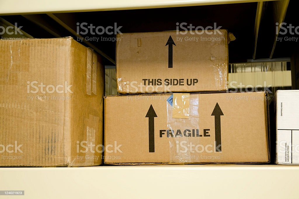 Boxes stacked on a shelf royalty-free stock photo