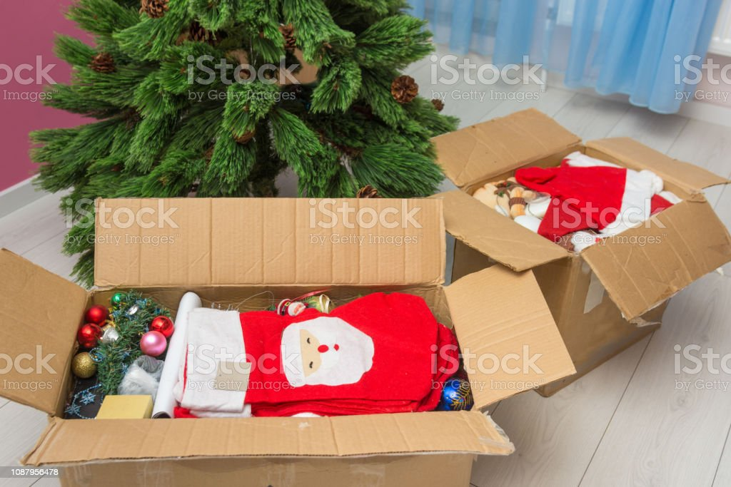 Artificial Christmas Tree Box.Boxes With Christmas Decorations In Front Of An Artificial