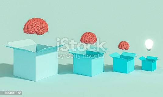 istock boxes with human brains and a lit light bulb. 1190801283