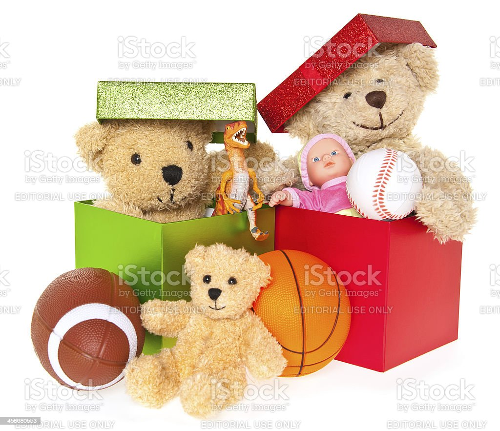 Boxes with Teddy Bear, Balls, Doll, Dinosaur and Toys royalty-free stock photo