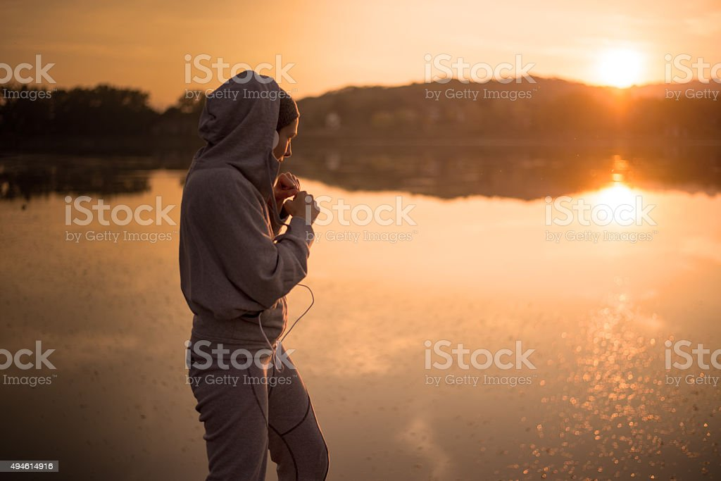 Boxing at sunset by the lake stock photo