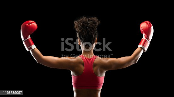 istock Boxing chamion afro girl raising her hands up 1193735057