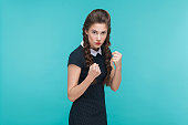 istock Boxing concept. Aggressive woman looking at camera with dangerous look. 925000732