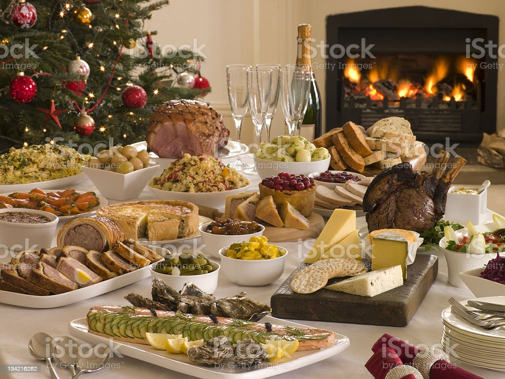 Boxing Day Buffet Lunch Christmas Tree and Log Fire stock photo