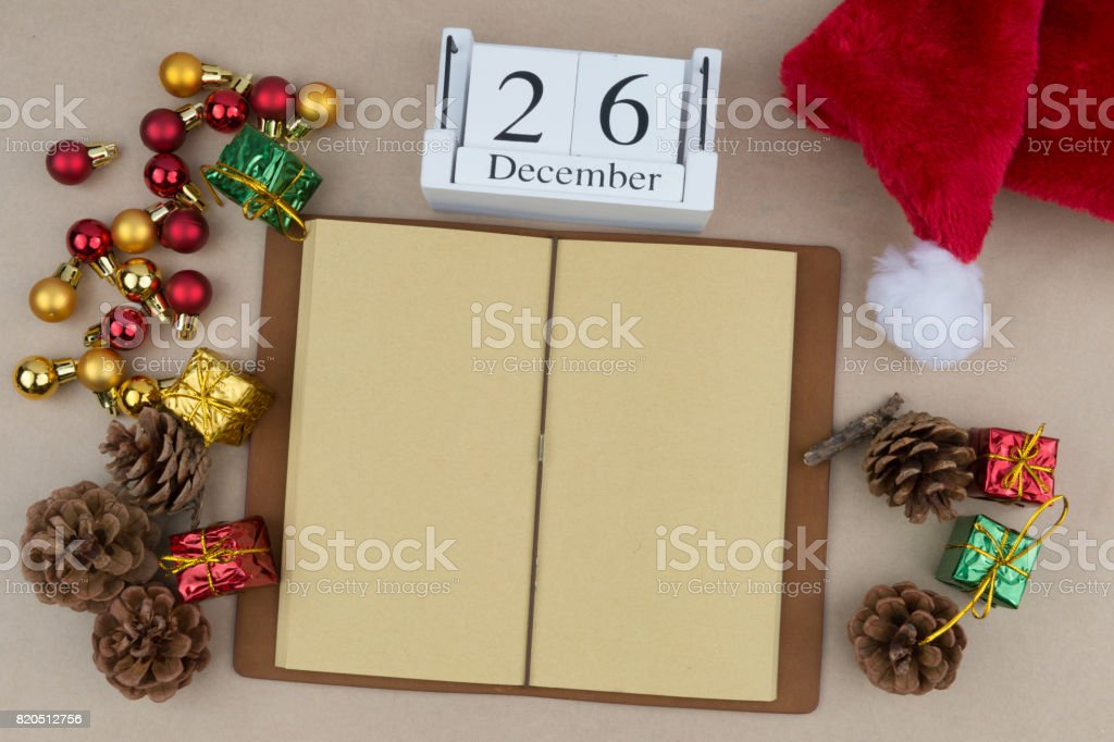 Boxing Day ,Christmas background with decorations, gift box and blank notebook. Space for text. Top view. stock photo