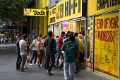 Melbourne, Australia - December 26, 2016: A large group of customers enter the JB Hi-Fi store on Elizabeth Street in the city. The electronics retailer had just opened for Boxing Day sales.