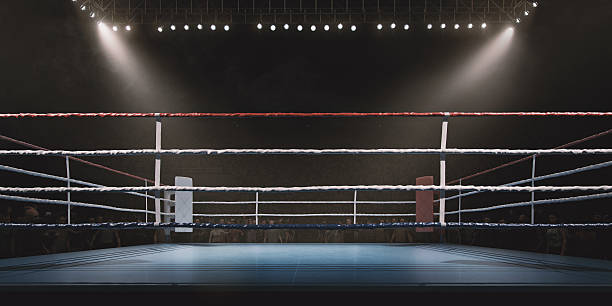 Boxing: Empty professional ring with crowd - foto de stock