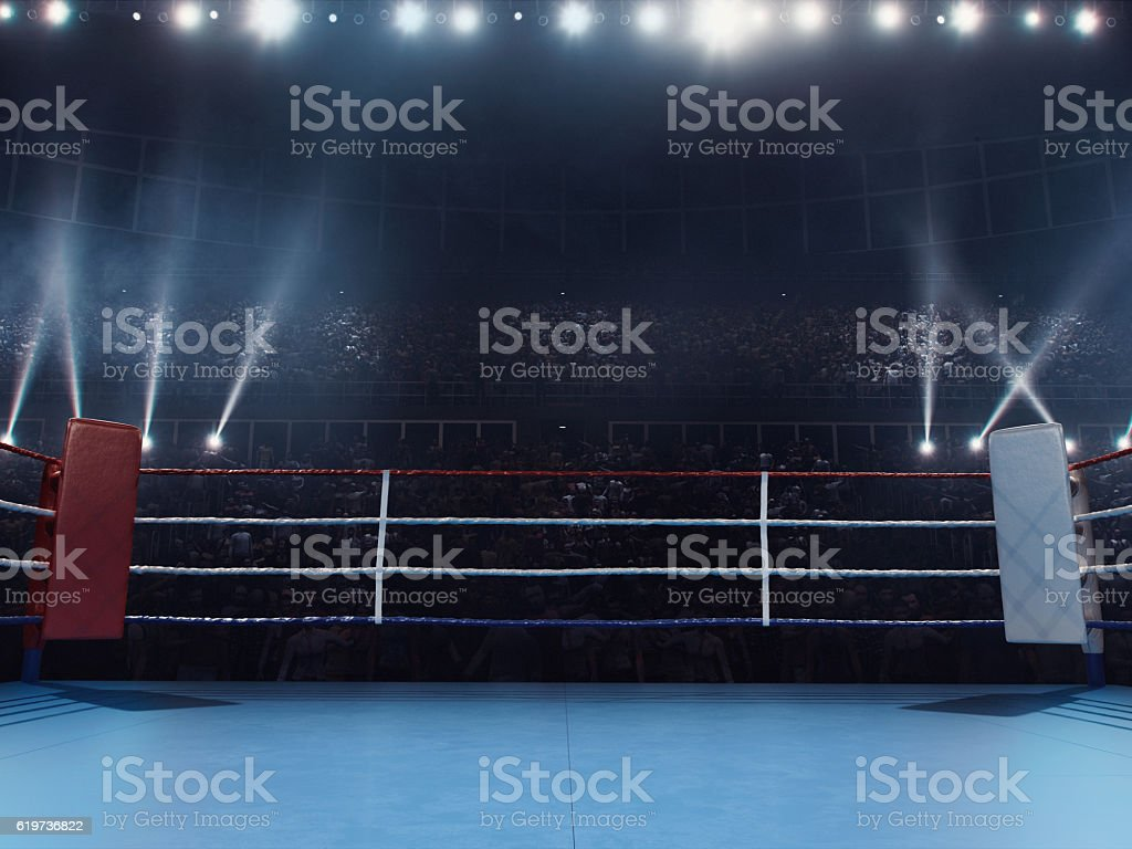 boxing empty professional ring with crowd stock photo