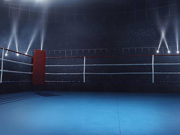 Boxing: Empty professional ring with crowd - fotografia de stock
