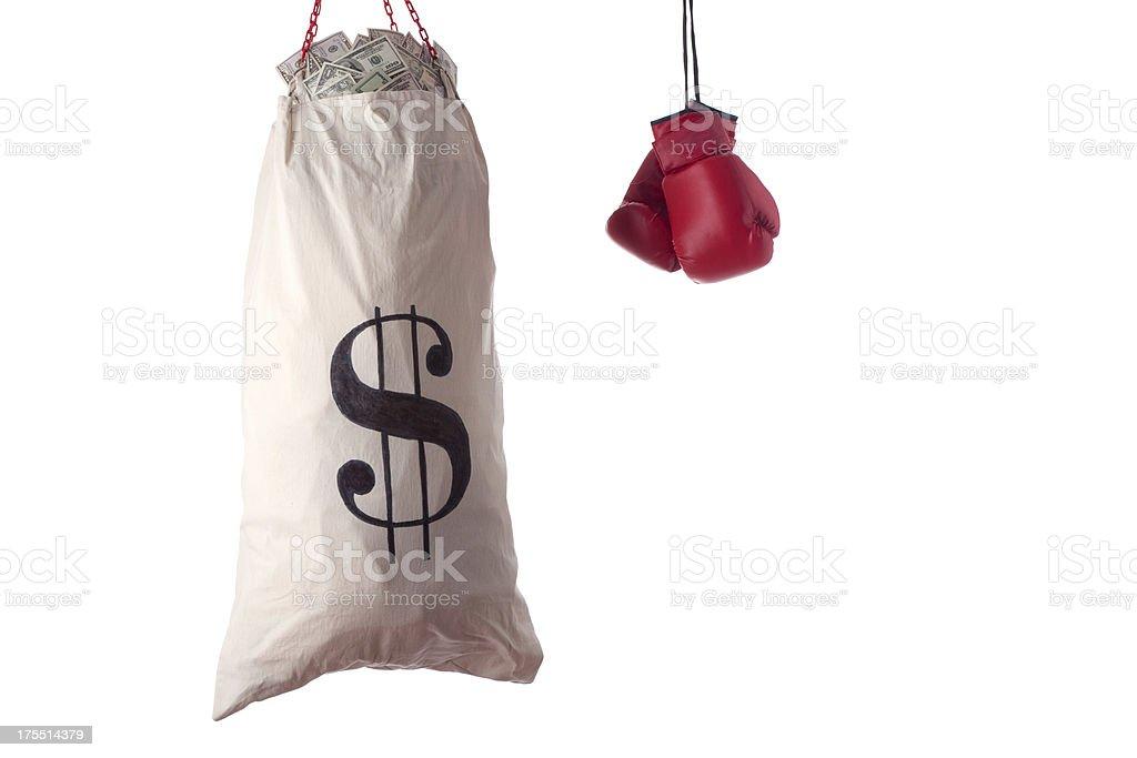 Boxing glove and punching bag full of us dollar bills royalty-free stock photo