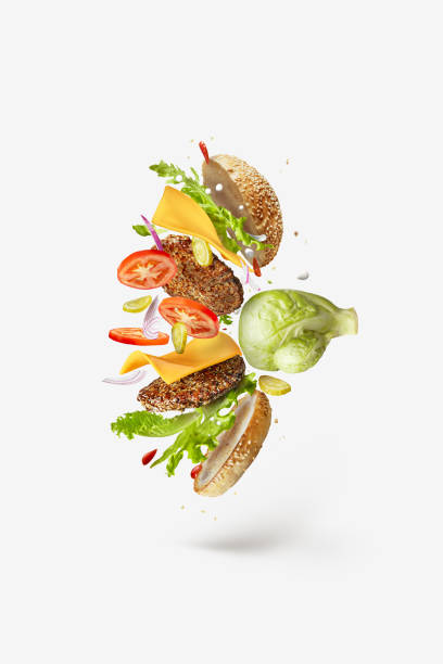Boxing glove as a natural cabbage is punching flying big tasty hamburger. stock photo