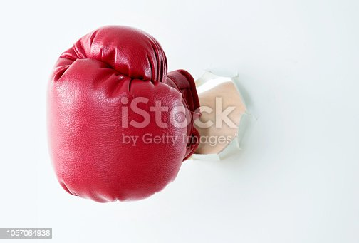 160558362 istock photo Boxing glove break out of cardboard 1057064936