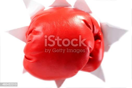 160558362 istock photo Boxing Glove Through a Hole in Paper 465452015