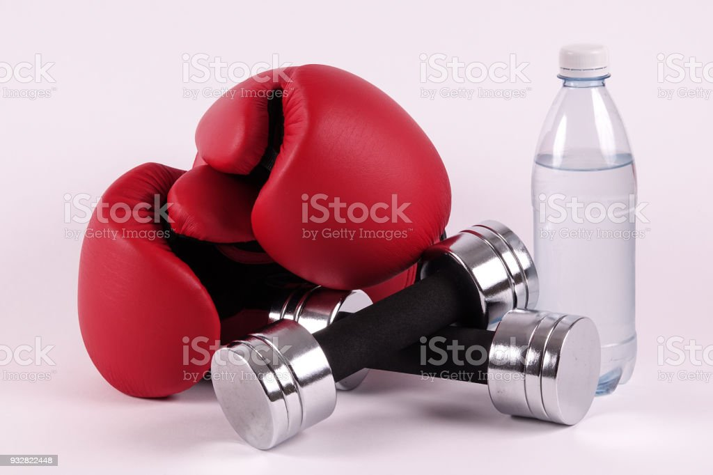 Boxing gloves and dumbbells stock photo