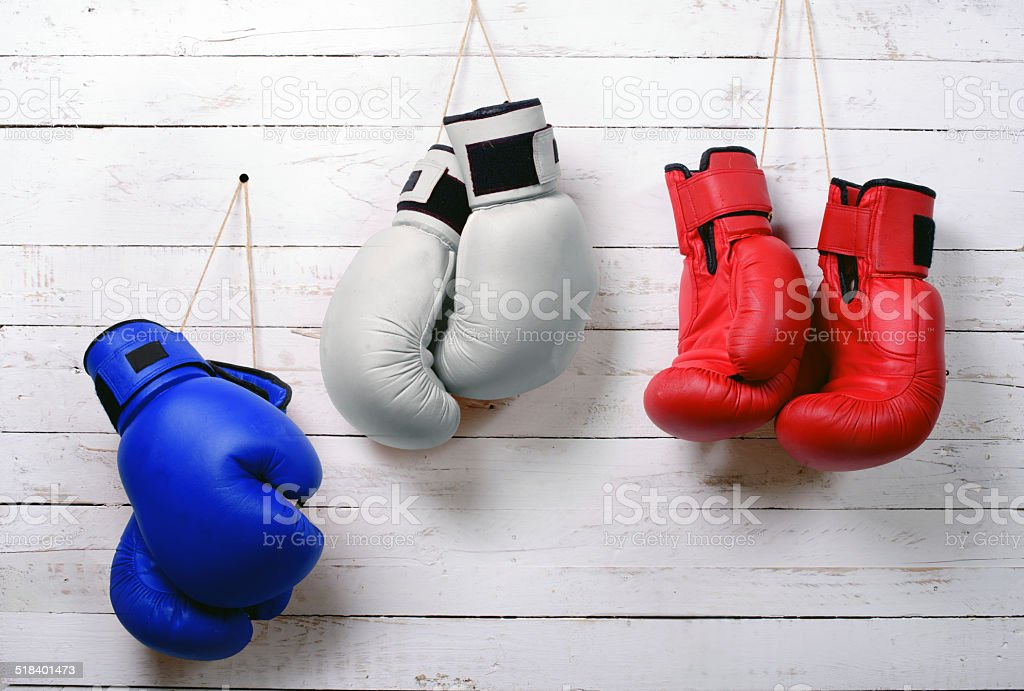 boxing gloves blue, white and red wall hung stock photo