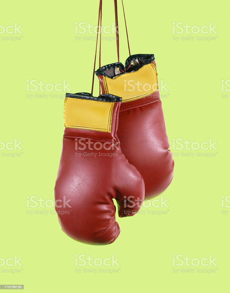 boxing gloves cut out on green stock photo