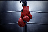 istock Boxing gloves hanging 1136522918