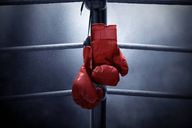 boxing gloves hanging - combat sport stock pictures, royalty-free photos & images
