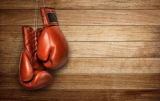 Boxing gloves hanging stock photo