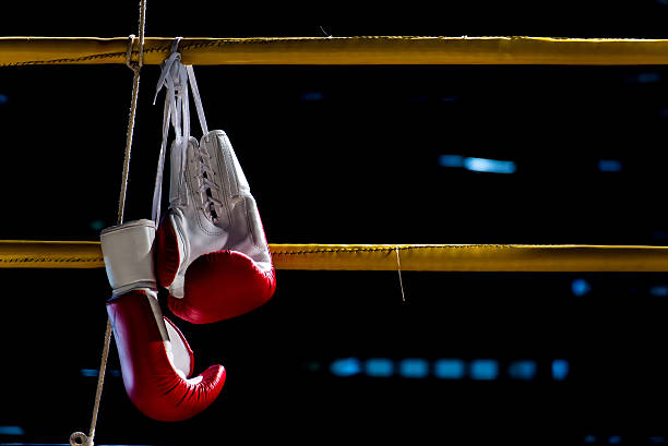 boxing gloves hangs off the boxing ring stock photo