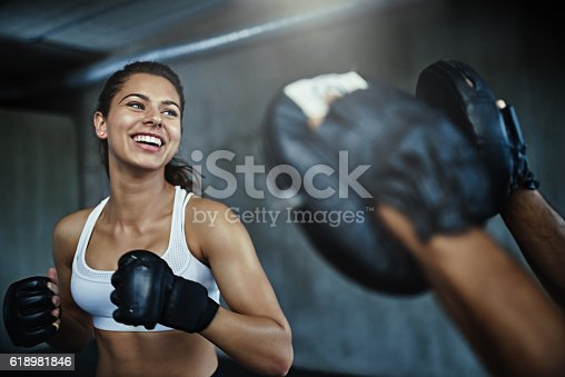 istock Boxing her way to a ripper body 618981846