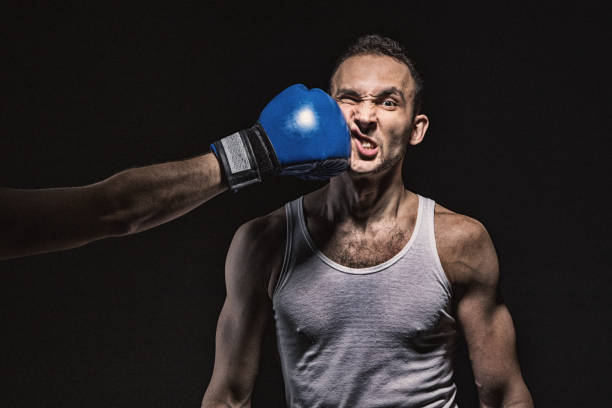 Boxing kick in the face stock photo