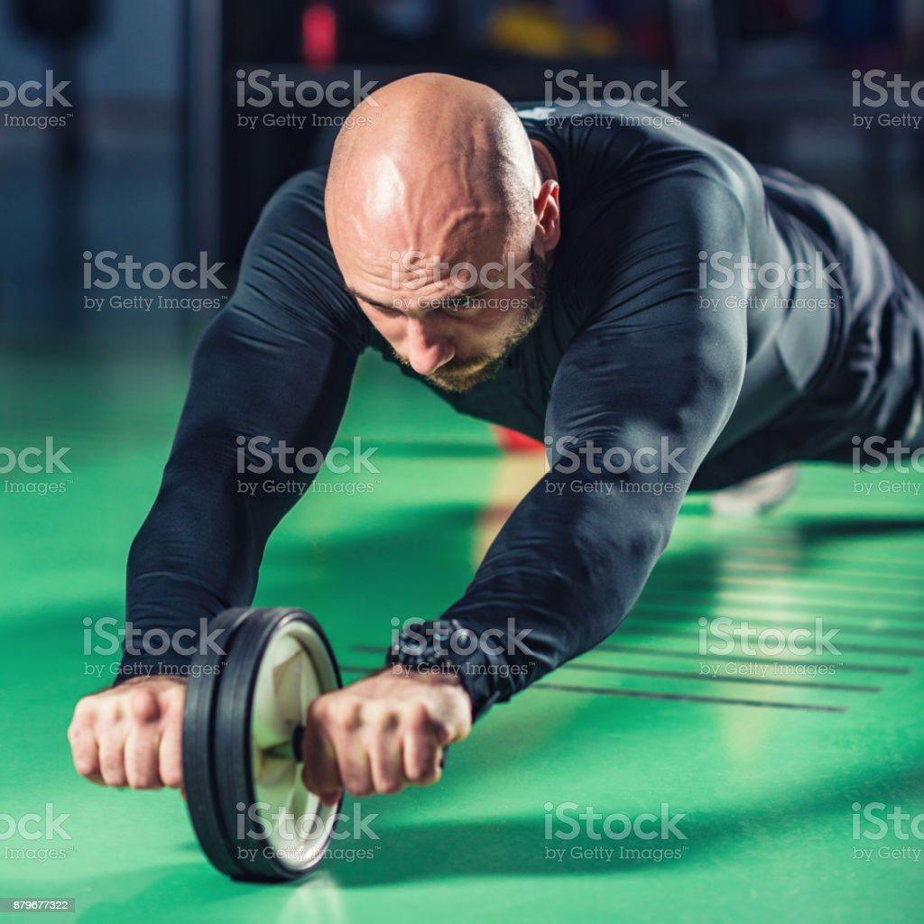 Boxing man exercising with roller stock photo