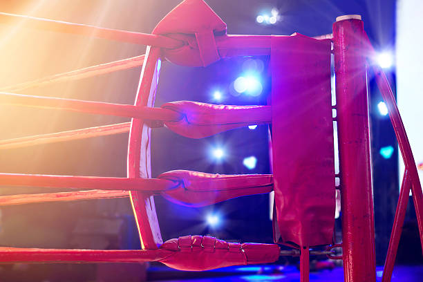boxing ring red corner and floodlights, dramatic lighting - wrestling stock photos and pictures