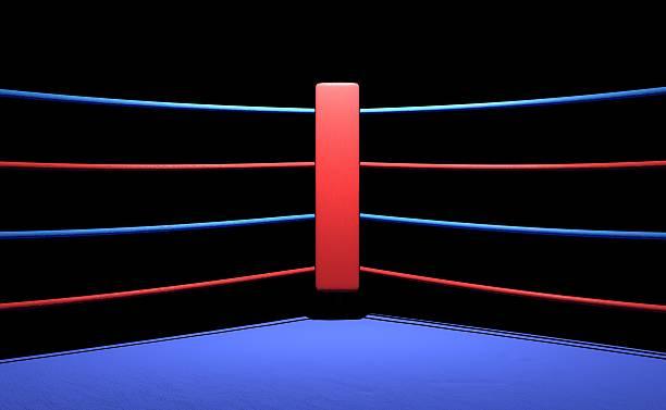 anillo de boxeo rojo en fondo oscuro esquina - foto de stock