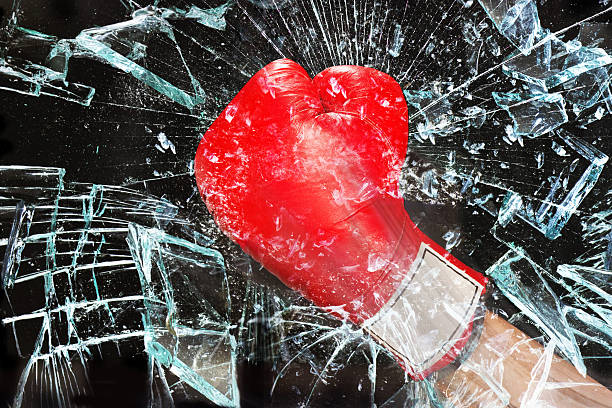 boxing through glass window. - punching stock photos and pictures