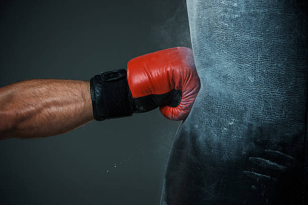 boxing training and punching bag - punching stock photos and pictures