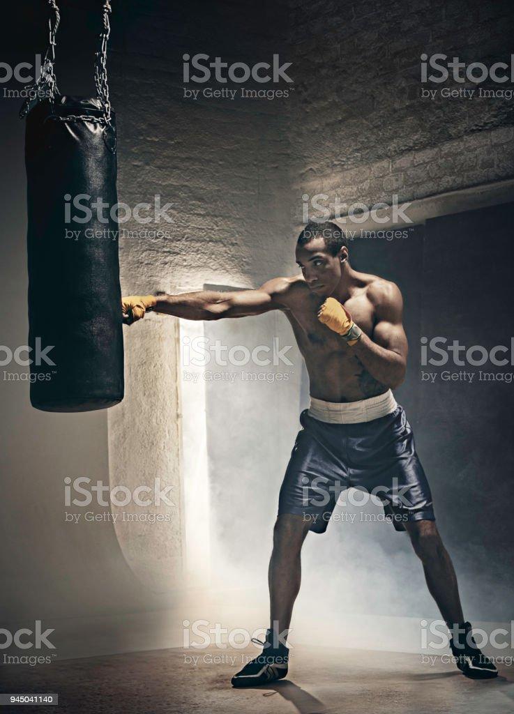 Boxing training and punching bag stock photo