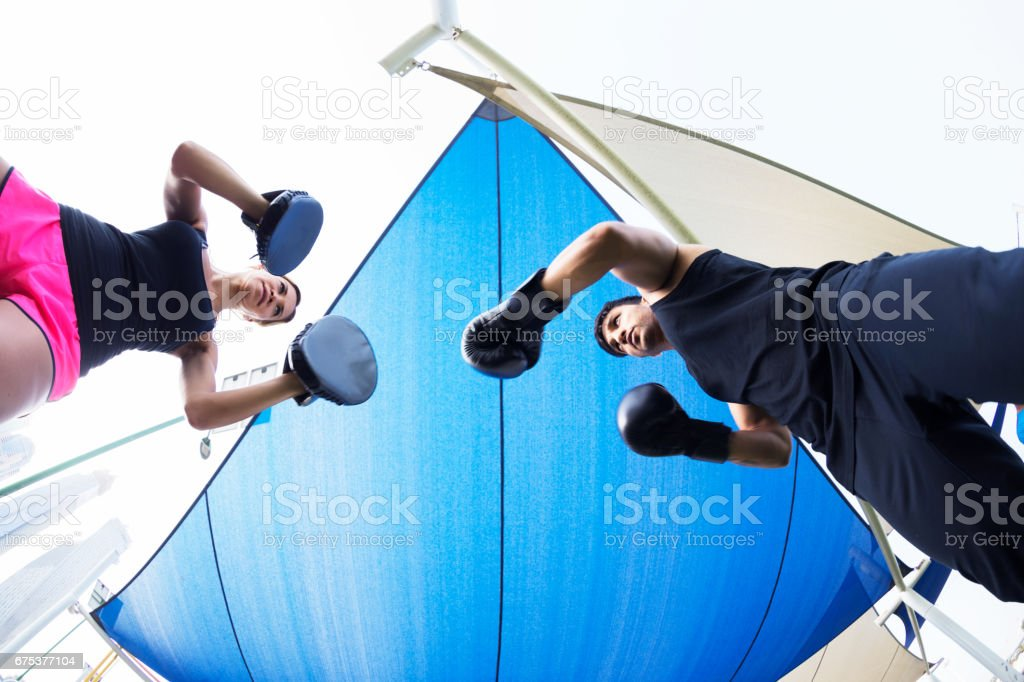 Boxing training with my personal trainer at an outdoor gym near Dubai Marina stock photo