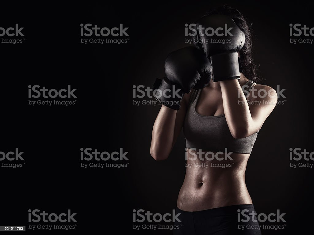 Boxing woman on dark background stock photo