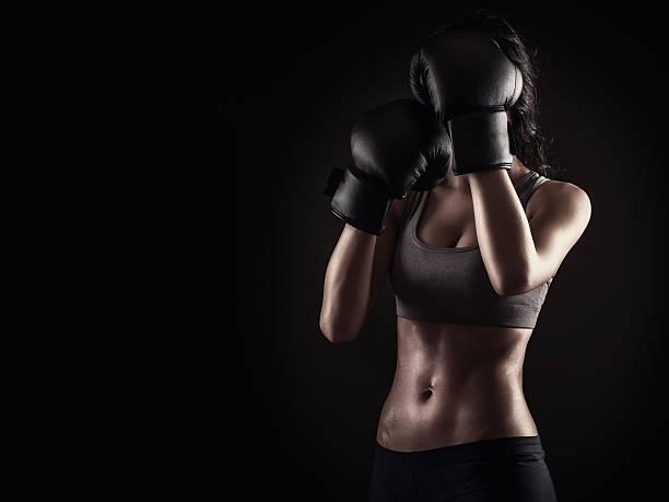 Boxing woman on dark background stock photo