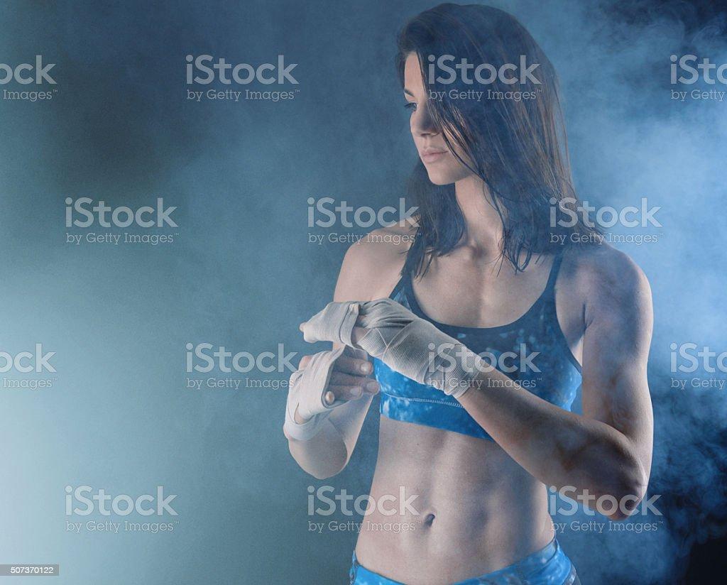 boxing woman preparing herself stock photo