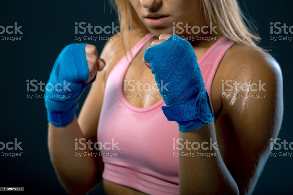 Boxing woman. Young woman fighter ready to fight. Strong woman....