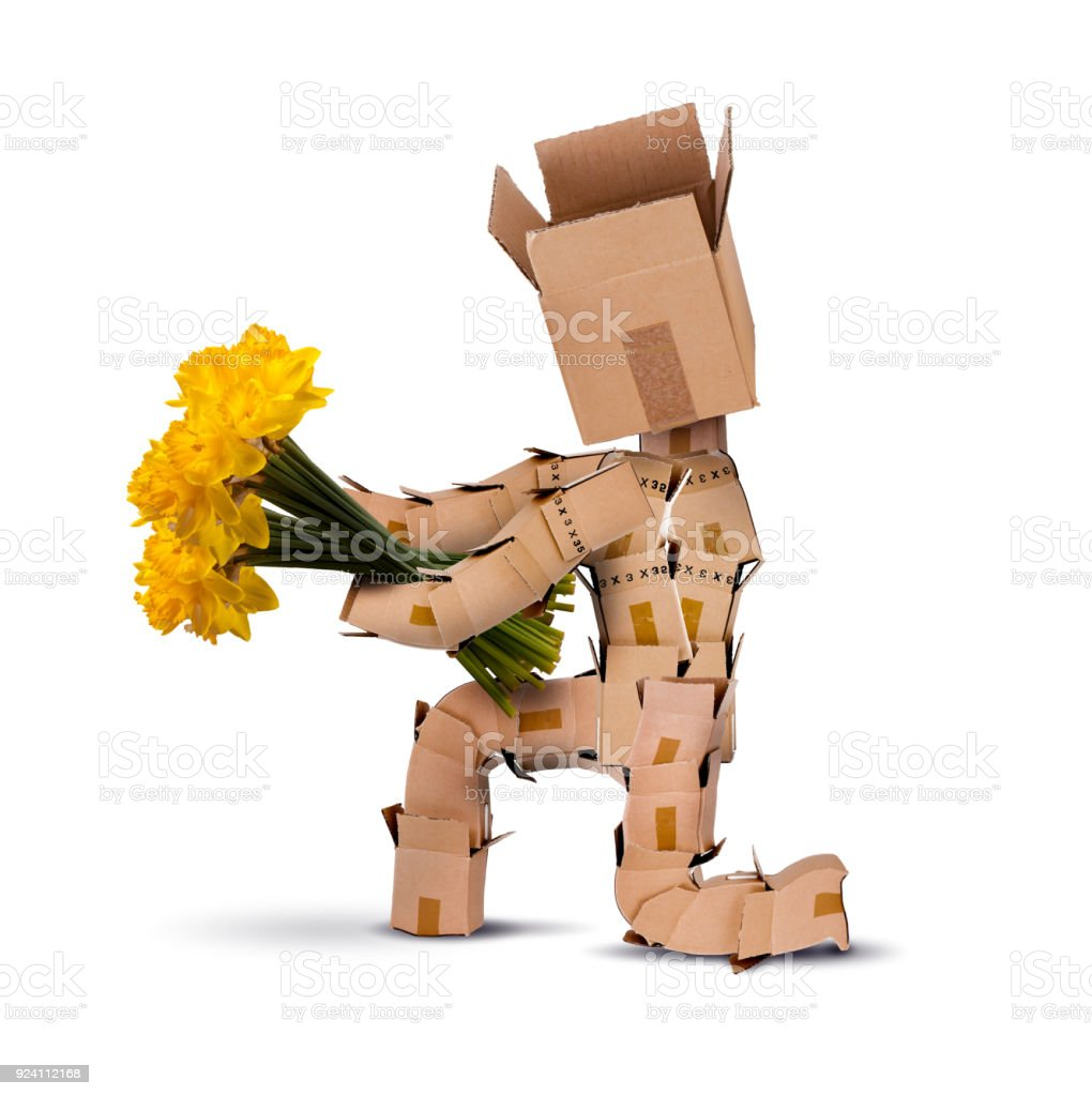 Boxman on bended knee with flowers stock photo